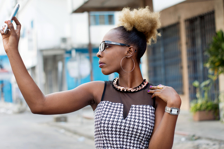 businesswoman taking selfie by smart phone outside Banque d'images - 119443946