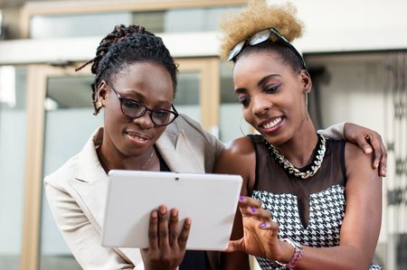 smiling businesswomen with tablet computers having discussion outdoor Banque d'images - 119443693