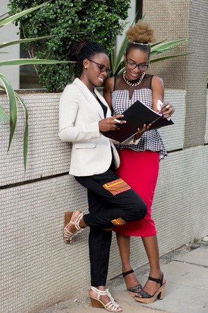 Young businesswomen find themselves in the business center for a deal outside.