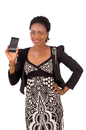 Portrait of smiling young woman showing a mobile phone isolated on white background