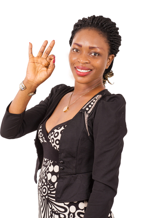 Portrait of happy young businesswoman and enjoying with hand signs