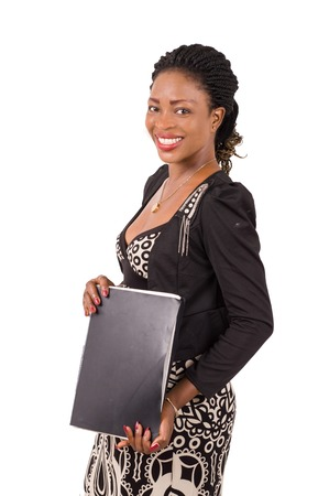 Young business woman smiling standing holding a folder black isolated on white background Imagens