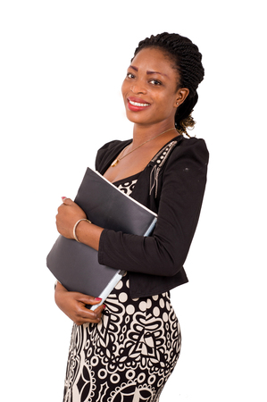 Smiling business woman holding a folder and looking at the camera.