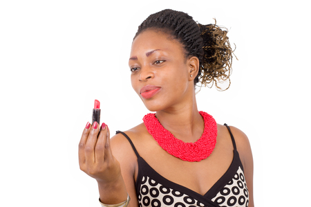 Portrait of a young woman holding lipstick and looking at him with joy.