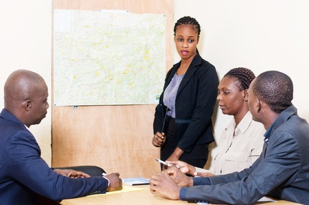 The businesswoman makes the presentation at the office of the company's new site at a meeting.