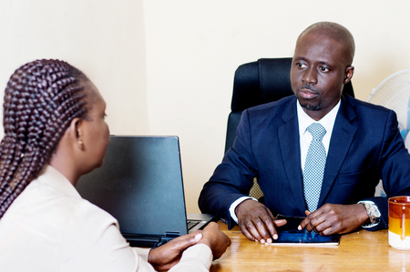 Business team with a laptop in front of them in a meeting at the office