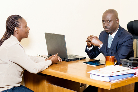Two business people sitting face to face discusses at the office. Stockfoto