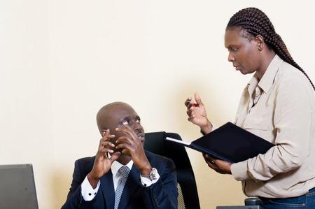 The boss explains something to his secretary.
