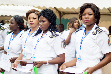 Abidjan, Ivory Coast - August 3, 2017: Epaulette and graduation ceremony for students leaving the Maritime Academy. group of marine women dressed in white and holding diplomas