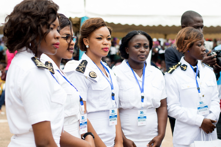 Abidjan, Ivory Coast - August 3, 2017: shoulder pad ceremony to students leaving the Maritime Academy. standing female sailor team wearing hospitality badges