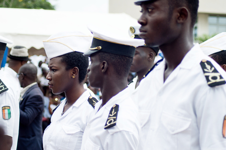 Abidjan, Ivory Coast - August 3, 2017: shoulder pad ceremony for students leaving the Maritime Academy. a group of young sailors dressed in blankets waiting for their diplomas.