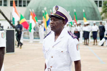 Abidjan, Ivory Coast - August 3, 2017: shoulder pad ceremony for students leaving the Maritime Academy. a senior officer standing in the row waiting for his decoration rounds Redactioneel