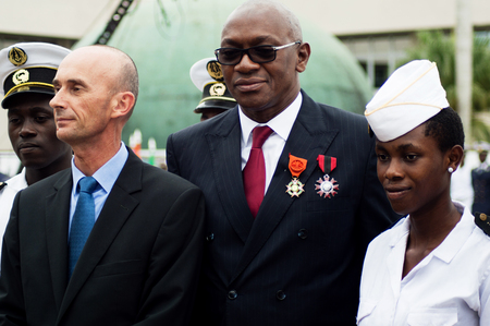 Abidjan, Ivory Coast - August 3, 2017: shoulder pad ceremony for students leaving the Maritime Academy. young sailors dressed in white next to their respective godfathers. Redactioneel