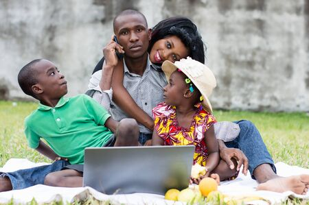 happy family playing together at the park during their holidays