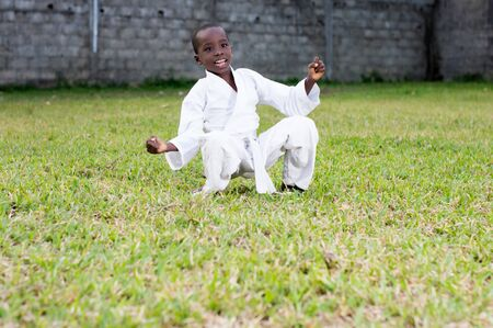 happy child practicing alone martial arts in the park Stockfoto - 128116267