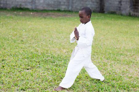 young boy alone in the park in kimono practice martial arts Stockfoto - 128116270