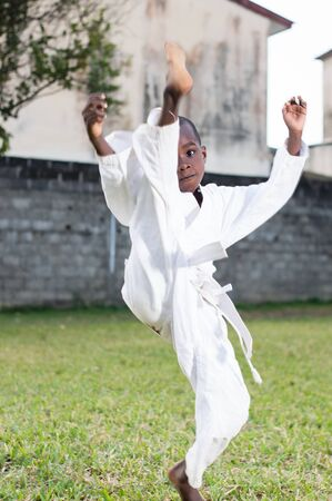 young child in kimono practicing karate