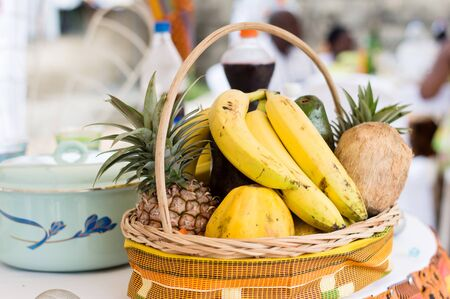 A basket of fresh fruit placed on a reception table