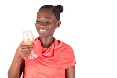 Smiling woman toasting alone Stockfoto - 128116094