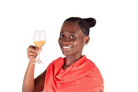 Beautiful happy woman holding a glass of fruit watching the camera and toast alone Stockfoto