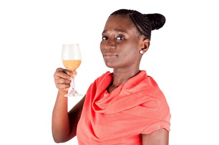Beautiful woman holding a glass of fruit in hand and watching the camera