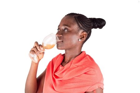 Young woman drinking fruit juice in a glass