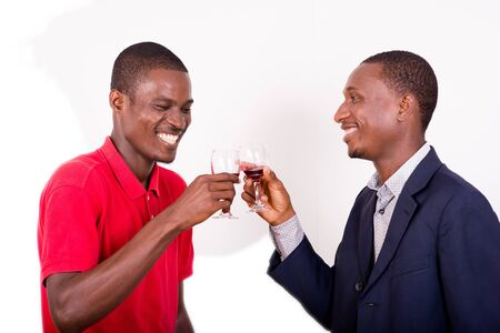 celebration, between two happy business people holding glasses of wine and toast