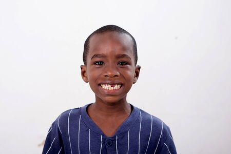 portrait of happy little african boy isolated on white background