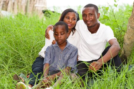 Portrait of smiling families sitting in the park relaxing and enjoying the nature
