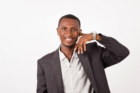 young happy businessman imitating the phone call. Business and communication concept