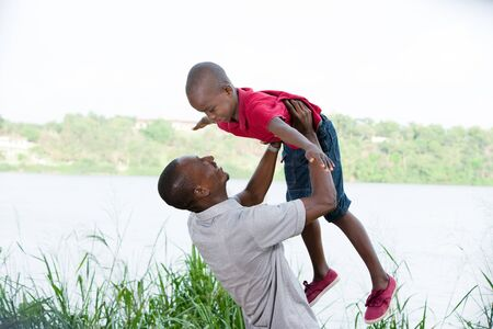 happy family in nature, father and son spending a pleasant time together in nature.Father holding his son in the air
