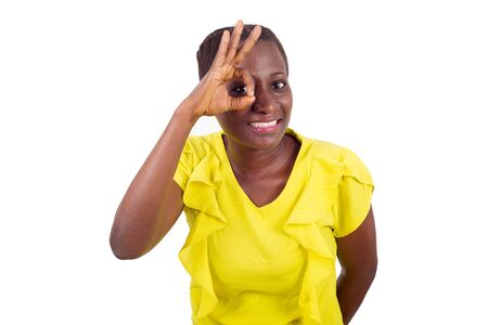 Happiness woman with a charming smile making a good gesture of being nice and showing the correct sign. Imagens