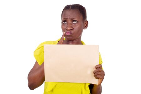 young pensive and worried woman and holding a blank sheet of paper, looking up to solve a problem in studio on a white background