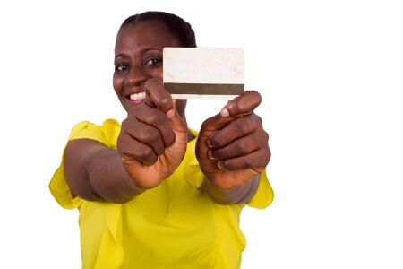 Happy woman standing on white background showing a credit card to the camera