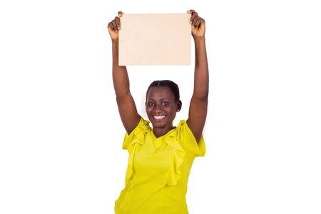 Smiling woman showing a blank sheet of paper with copy space for advertising on white studio background