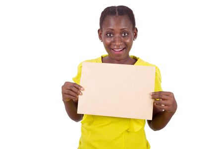 young girl standing in yellow camisole with envelope glued to the chest looks at the camera smiling. Stock Photo