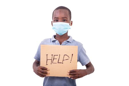 little boy wearing a medical mask, pointing his finger at a text HELP! Stock Photo