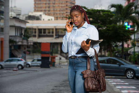 student girl in a city street talking on the phone .concept education and communication Stockfoto