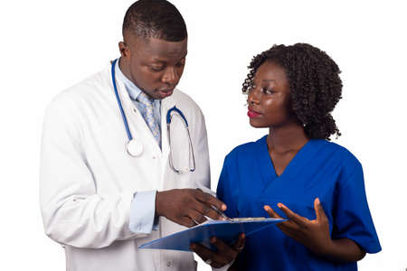 young trainee standing in uniform looking at doctor show him work.