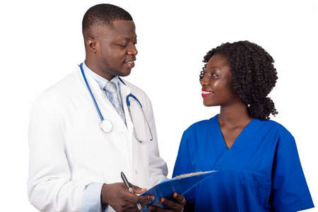 young trainee standing in uniform looking at doctor show him work smiling.