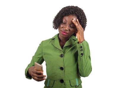 young woman suffering from headache desperate and stressed by pain and migraine and uses on a mobile phone. Hands on the head.