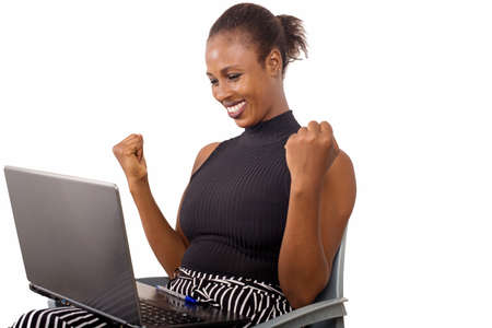 Attractive beautiful businesswoman having success in business. Charming beautiful woman holding a laptop and looking for some business information. 免版税图像