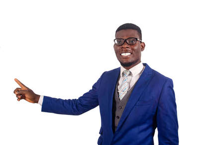 handsome young business man wearing happy glasses with a smile of face pointing with the hand and the finger aside and looking at the camera smiling Stock Photo