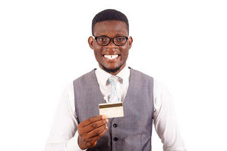Handsome business man holding credit card with a happy face standing and smiling with a confident smile showing teeth