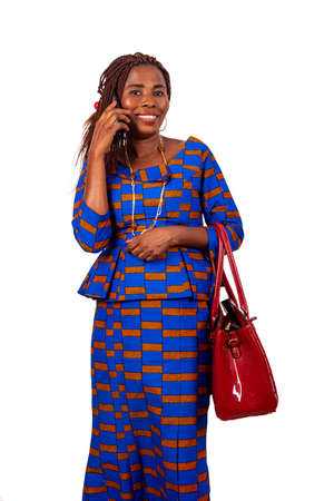 beautiful adult businesswoman wearing a traditional loincloth and talking on mobile phone smiling