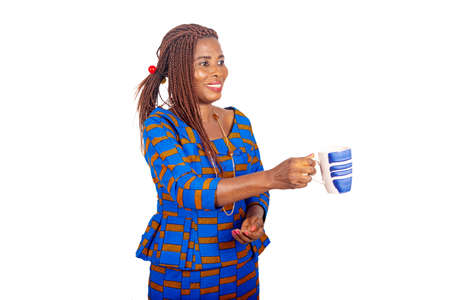 beautiful adult woman wearing a traditional loincloth giving a cup of coffee while smiling