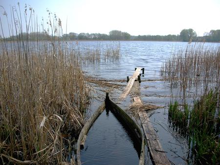 drown: Old Sunken Wooden Fishing Boat In River. Stock Photo