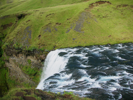 Skogafoss is a waterfall located in the south of Iceland at the cliffs of the former coastline. After the coastline had receded seaward, the former sea cliffs remained so, the waterfall was formed.
