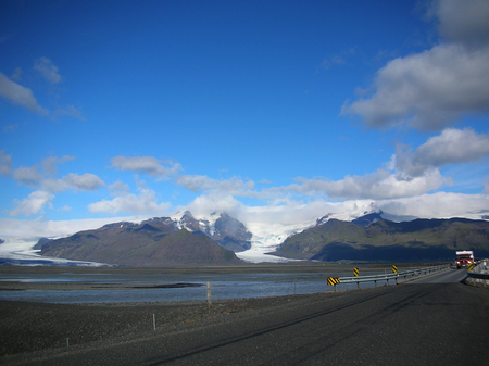 lenticular: Road between the mountains and lava fields. Beautiful summer landscape, Iceland.