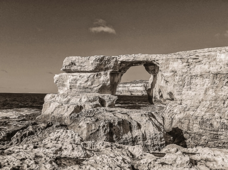 hole: Azure window, natural hole of rocky cliff and blue Mediterranean sea